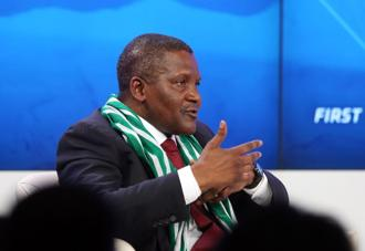 Aliko Dangote, chief executive officer of Dangote Group. About a half-dozen of the wealthiest participants in World Economic Forum, Davos said stocks will rise, interest rates will remain low and they'd avoid investing in the virtual currency Bitcoin in 2014. Photo: Bloomberg
